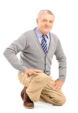 Smiling mature man kneeling